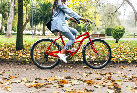 young woman riding a bike in