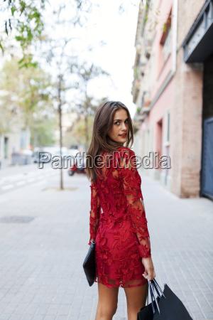 beautiful young woman wearing red dress