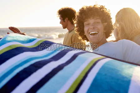 happy young man with towel on