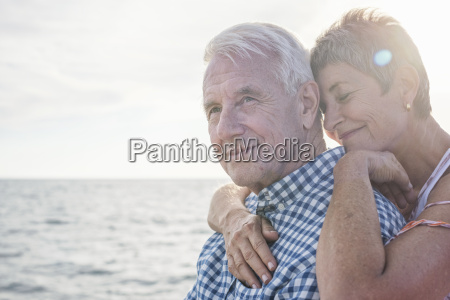 affectionate couple by the sea