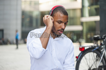businessman listening music with headphones