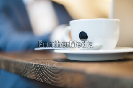 close up of businessman cup of