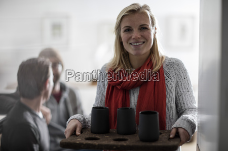 young woman serving coffee