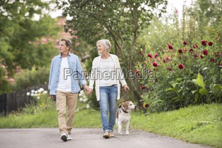 senior couple on a walk with