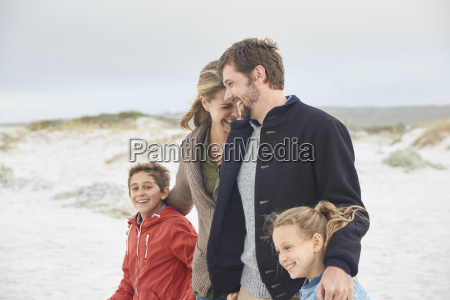 happy family walking on winter beach