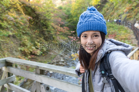 woman taking selfie at outdoor landscape