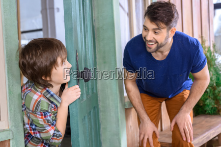 side view of smiling father and