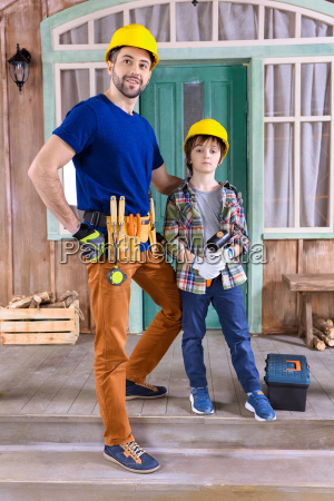 father and son in helmets with