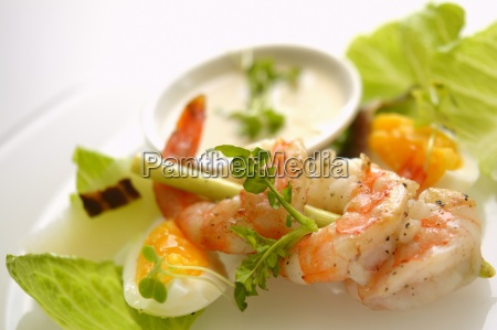 a prawn kebab with egg and