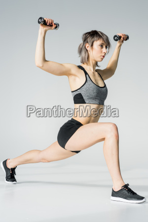 side view of young sportswoman exercising