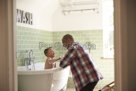 father and son having fun at