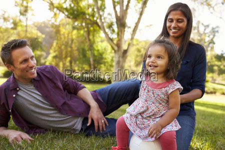 mixed race parents and young daughter