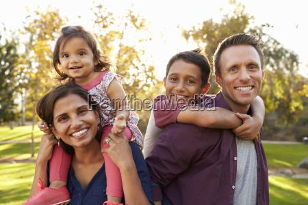 mixed race parents carry their kids
