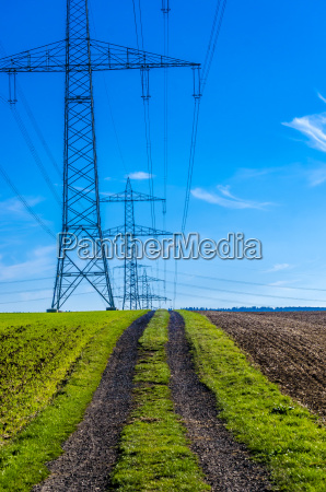 row of high voltage poles with