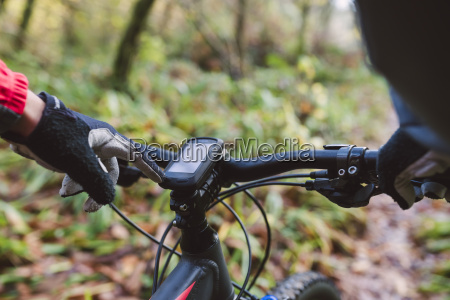 mountain biker using gps of his
