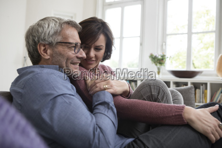 smiling mature couple at home on