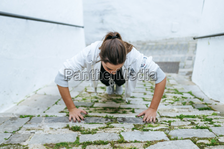 young woman doing push ups in