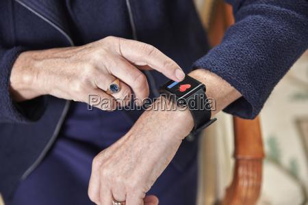 senior woman checking medical data on