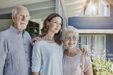 parents with grown up daughter portrait