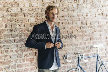 businessman buttoning jacket