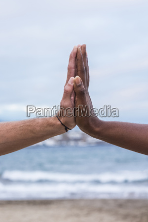 close up of two hands touching