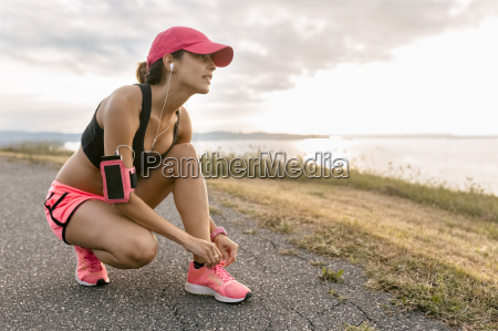 young woman warming up for training