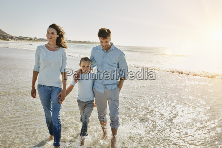 couple with daughter walking on the