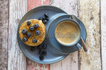 dish with pancakes blueberries with maple