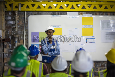 construction engineers getting a safety briefing