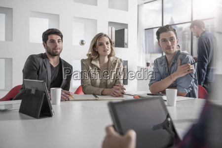casual business meeting in boardroom with