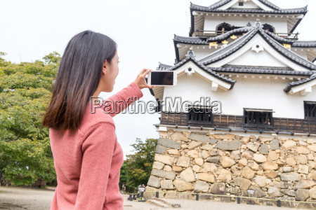 woman taking photo on hikone castle
