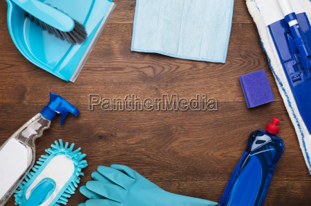 cleaning equipment on wooden desk