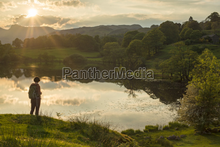 a woman looks out over loughrigg