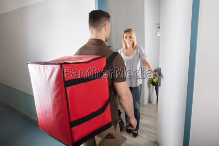 pizza delivery man with large red