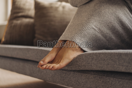 close up of womans feet sitting