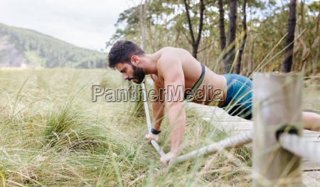 barechested man exercising outdoors