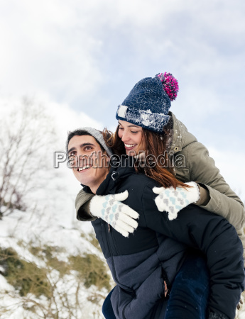 young man carrying his girl fried