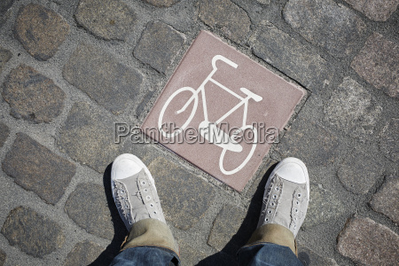 person standing next to pictogram with