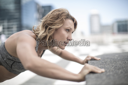 young woman exercising in the city