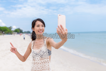 woman taking sefie with cellphone in