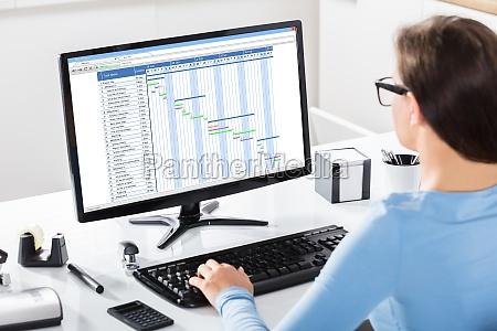 businesswoman working on gantt chart on