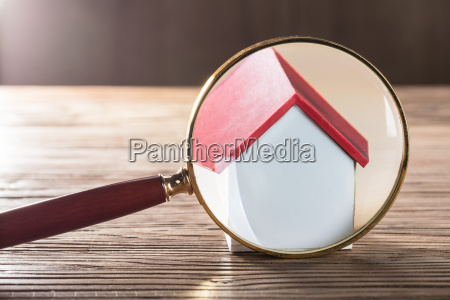 house model seen through magnifying glass