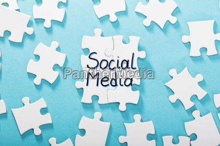social media word made with puzzle