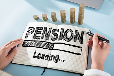 businessperson drawing pension chart on checker