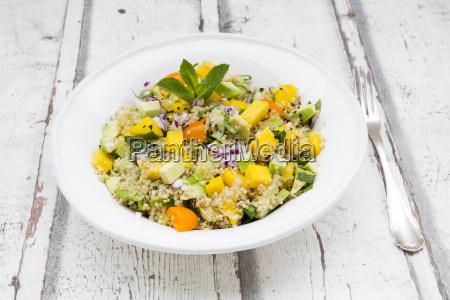 plate of quinoa salad with mango