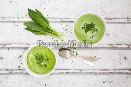 two bowls of ramson soup garnished