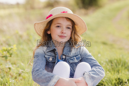portrait of girl wearing straw hat