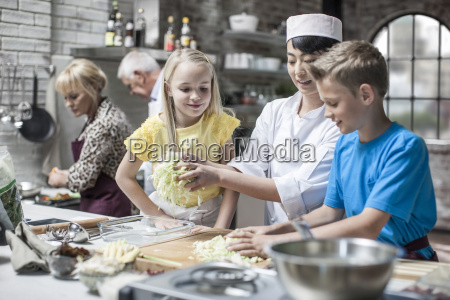 female chef instructing kids in cooking