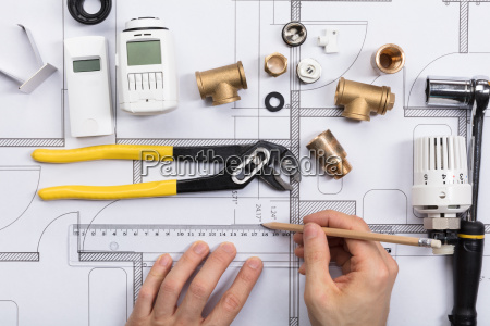 an architect working on blueprint with