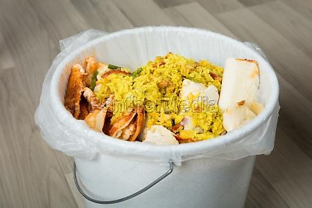 leftover food in trash bin